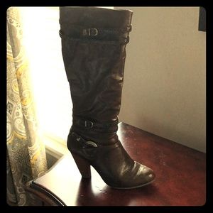 Knee high boots with snake print accent